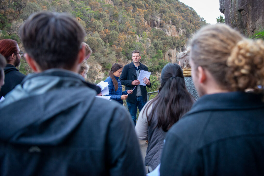Associates gathered outside in Tasmania for their Mid-Year Intensive